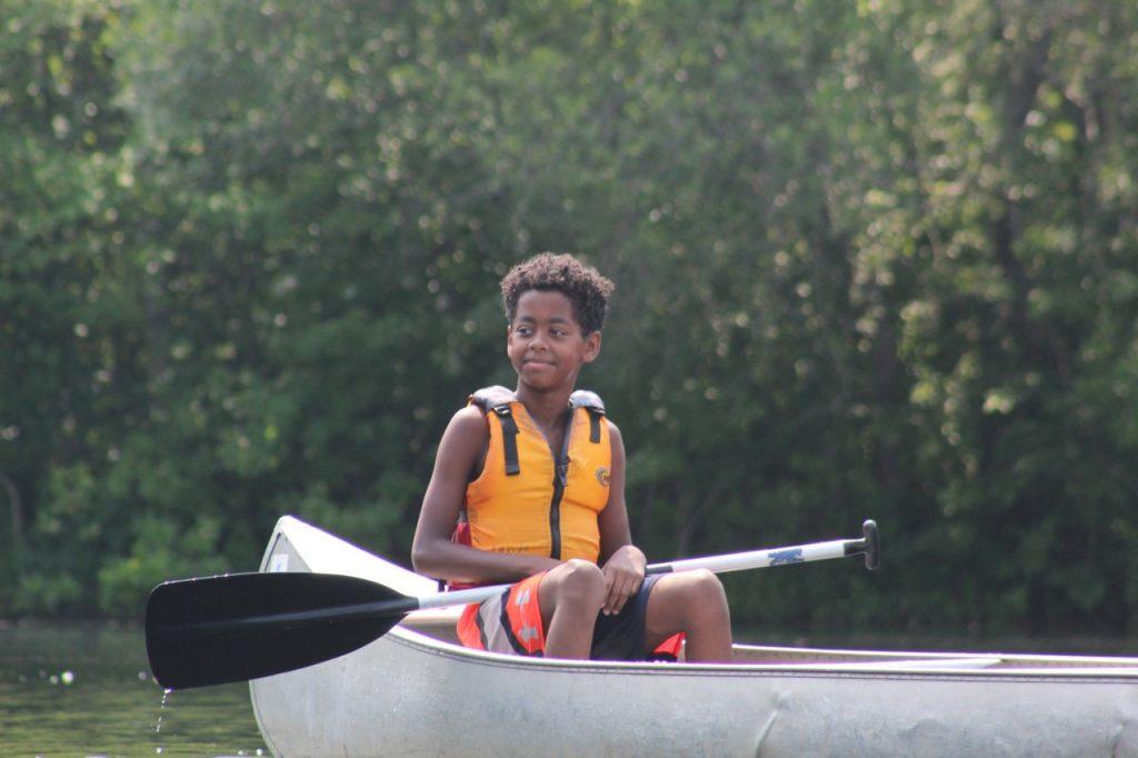 kid in canoe